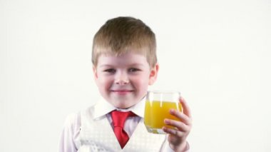Little boy holding glass of juice — Stock Video