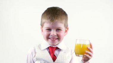 Little boy holding glass of juice — Stock Video