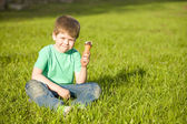 Little boy in  park eating ice cream — Stock Photo