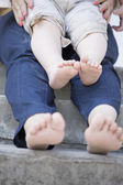 Tiny legs of  child and his mother — Stock Photo