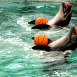 Dolphins with four balls in pool — Stock Photo