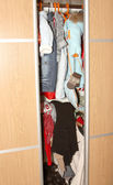 Clothes hang in the closet — Stock Photo