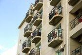 Balconies on a hotel building — Stock Photo
