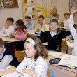 Children at school at a lesson lift hands — Stock Photo #12608010