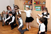 The teacher and children at school dance — Stock Photo