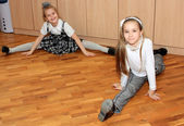 Two girls at school do gymnastics — Stock Photo