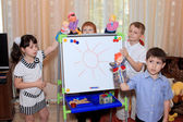 Children play in a game room — Stock Photo
