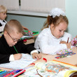 Children at a lesson write in writing-books — Stock Photo