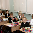 Children at school are engaged at a lesson — ストック写真