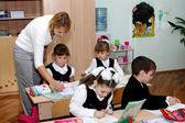 The teacher explains to children a lesson — Stock Photo