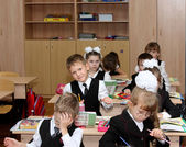 Children at school are engaged at a lesson — Stock Photo