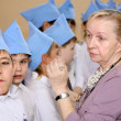 The elderly woman stands near children in blue garrison caps — Stock Photo