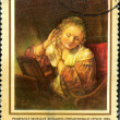 Stamp with the picture image Rembrandt the Young woman who is trying on earrings, 1654 — Stock Photo