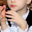 Stock Photo: Girl with made-up nails on hands