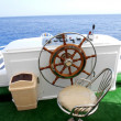Stock Photo: Steering wheel on yacht
