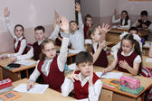 Pupils sit at a school desk at the Russian school at a mathemati — Stock Photo