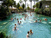 Pamukkale, Turkey, on July 20, 2014: unknown tourists swim in th — Stock Photo