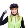 Cyclist pointing to the helmet — Stock Photo