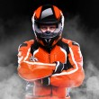 Biker in helmet on black background — Stock Photo