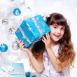 Girl holding the gift box — Stock Photo