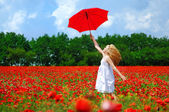 Girl over the poppy field — Stock Photo