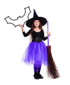 Halloween witch in violet skirt — Stock Photo