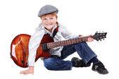 Happy boy guitar player — Stock Photo
