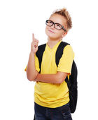 Schoolboy pointing to the copy space area — Stock Photo