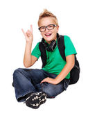 Happy schoolboy in headphones — Stock Photo