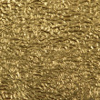 Closeup gold foil surface — Stock Photo