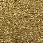 Closeup gold foil surface — Stock Photo