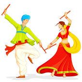Couple playing Dandiya — Stok Vektör
