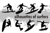 Silhouettes of surfers — Stock Vector