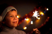 Boy with fireworks — Stock Photo