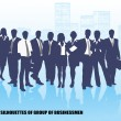 Silhouettes of businessmen against megalopolis — Stock Vector #16624969