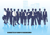 Silhouettes of businessmen against the megalopolis — Stock Vector