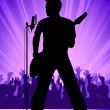 Rock musician on a scene — Stock Vector