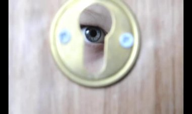 Eye in a keyhole — Stock Video