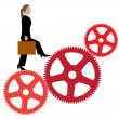 Stock Vector: Business womwalks on mechanism