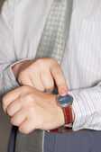 Businessman and watch — Stock Photo