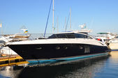 Black yacht in the port of Odessa — Stock Photo