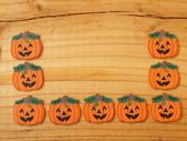 Pumpkins on a board — Stock Photo