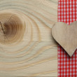 Wooden background with a checked ribbon — Stock Photo #37130115