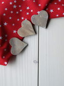 Wooden background with hearts — Stock Photo