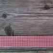 Wooden background with a checked ribbon — Stock Photo #43027037