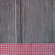 Wooden background with a checked ribbon — Stock Photo #43027703