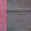 Wooden background with a checked ribbon — Stock Photo #43027859