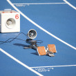 Stock Photo: Start block of sprinters and loudspeaker