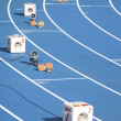 Start block of sprinters and loudspeaker — Stock Photo #12600049