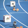 Start block of sprinters and loudspeaker — Stock Photo